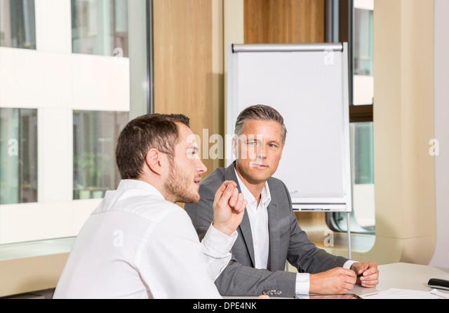 Businessmen meeting in conference room - Stock-Bilder