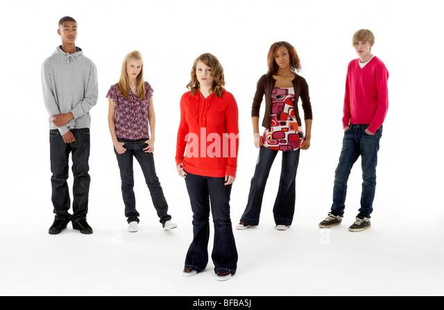 Full Length Studio Portrait Of Five Teenage Friends - Stock Image