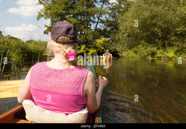 Canoeing UK - People canoeing on the River Lodden, a tributary of the Thames, Berkshire England UK - Stock Image