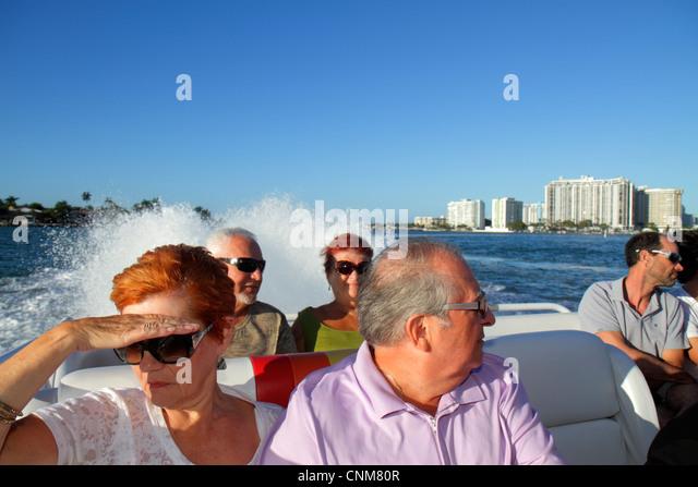 Miami Beach Florida Biscayne Bay Thriller Speedboat tour senior man woman couple - Stock Image