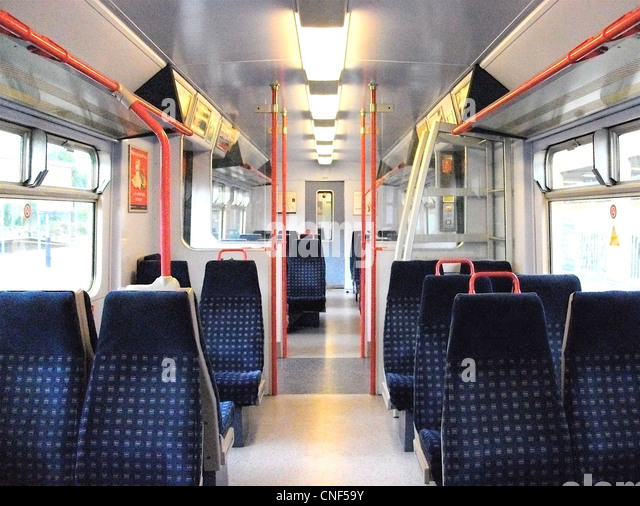 Half internal view of Standard Class accommodation aboard a refreshed First Capital Connect Class 319/4 EMU. - Stock Image