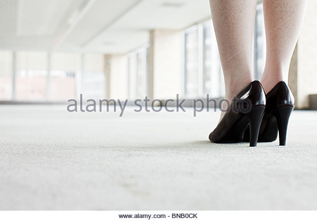 Shoes of woman in office - Stock Image
