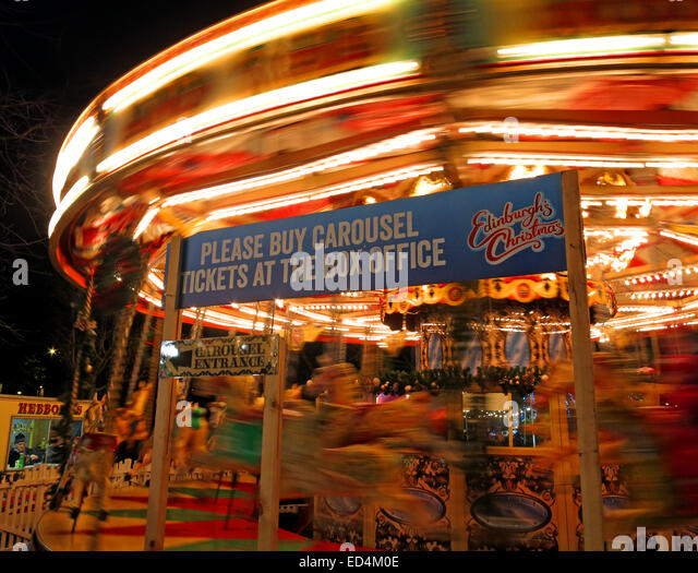 Traditional fairground attractions at Night at Edinburgh's Hogmanay - Stock Image