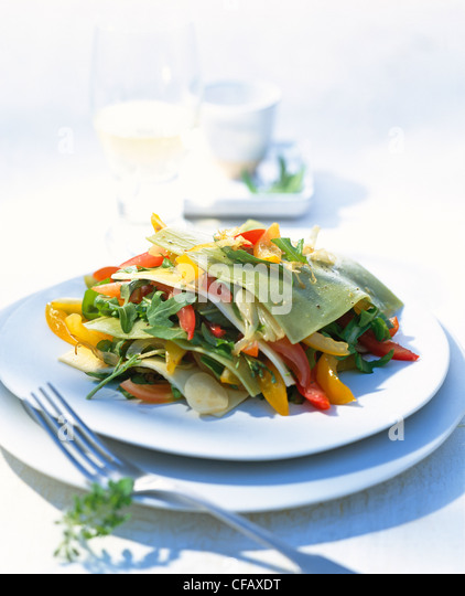 Lasagne with fresh tomato salad - Stock Image