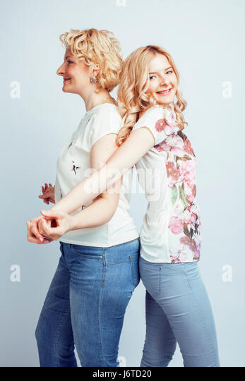 mother with daughter together posing happy smiling isolated on white background with copyspace, lifestyle people - Stock Image