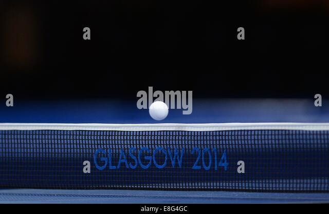 The ball going over the net. Table tennis.Scotstoun Sports Campus, Glasgow, Scotland, UK -  270714 - Glasgow 2014 - Stock Image