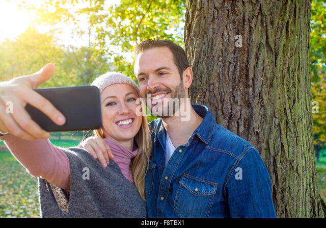 Couple taking a selfie - Stock-Bilder
