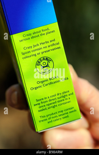 Organic food label certification notice on a packet - Stock Image