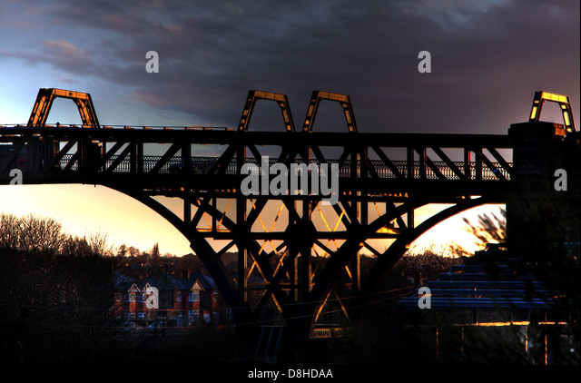 Cantilever steel bridge over Manchester Ship Canal , Latchford Warrington , Cheshire England UK at dusk - Stock Image