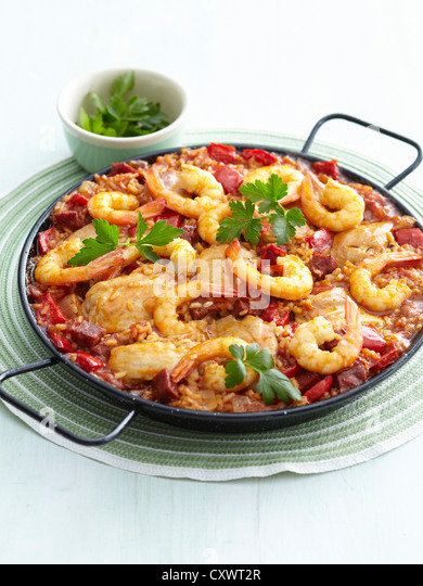 Dish of chicken and shrimp paella - Stock Image
