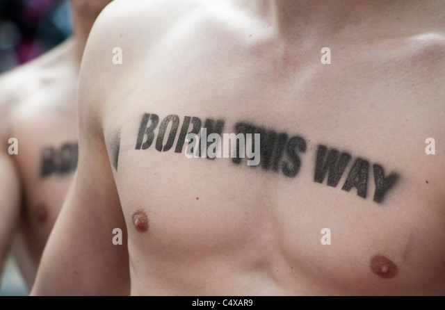 Men with gay pride message stencilled on their bare chests at the Christopher Street Day Parade in Berlin Germany - Stock-Bilder