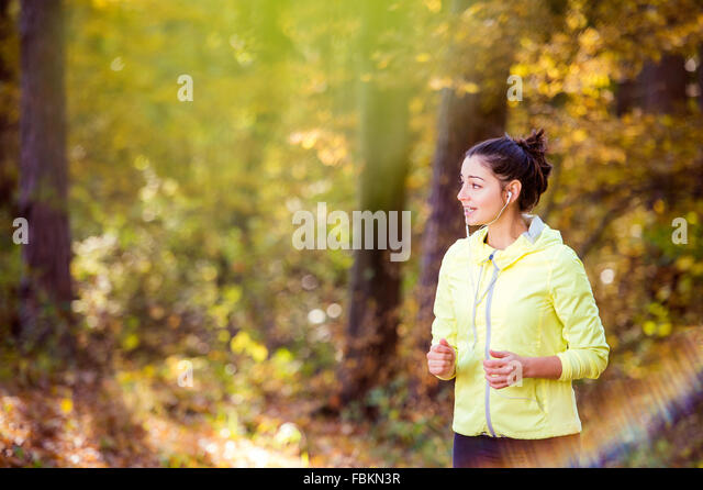 Young woman running - Stock-Bilder