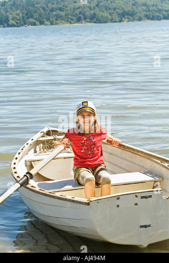 Young girl in row boat - Stock Image