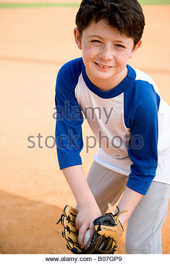 Boy with catcher's mitt and baseball - Stock Image