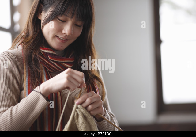A woman knitting together - Stock Image