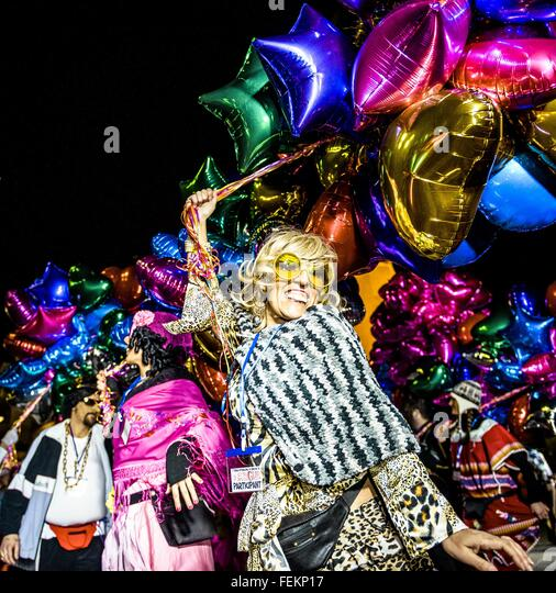 Sitges, Catalonia, Spain. 7th Feb, 2016. Revelers in their colorful costumes dance in street during the 'Parade - Stock Image