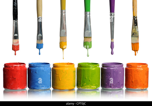 Paintbrushes dripping paint of various colors into containers - Stock Image