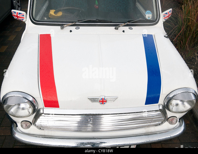 An historic 1993 white BMC Mini 1275 motor car decorated with Union Flags - Stock Image
