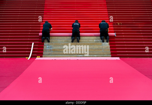 Europe, France, Alpes-Maritimes, Cannes film festival, carpet installation for red carpet. - Stock Image