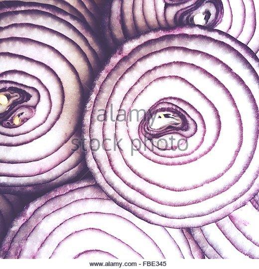Full Frame Shot Of Red Onion Slices - Stock-Bilder
