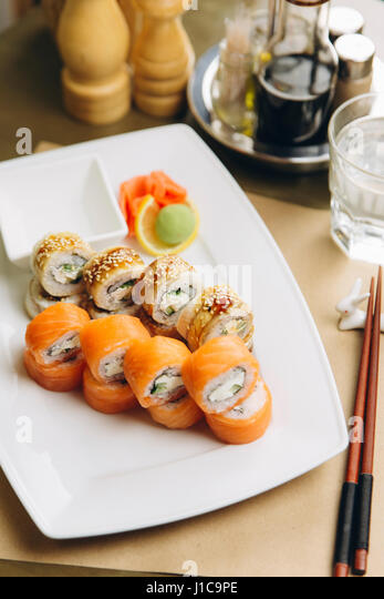 Sushi on plate with chopsticks - Stock Image
