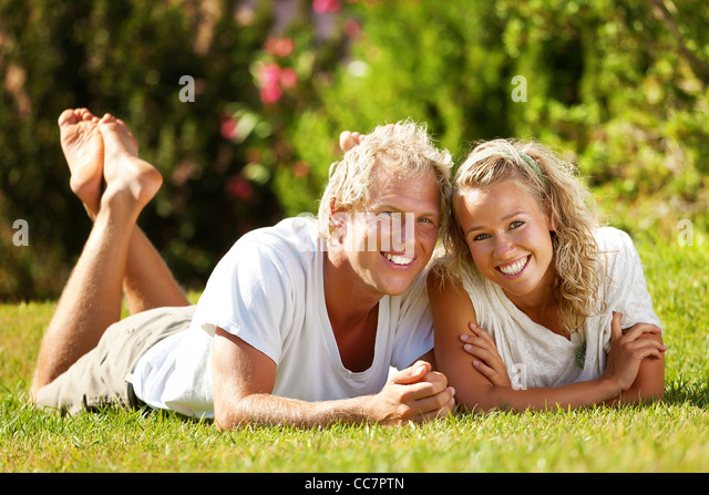 Happy young couple outdoors - Stock Image