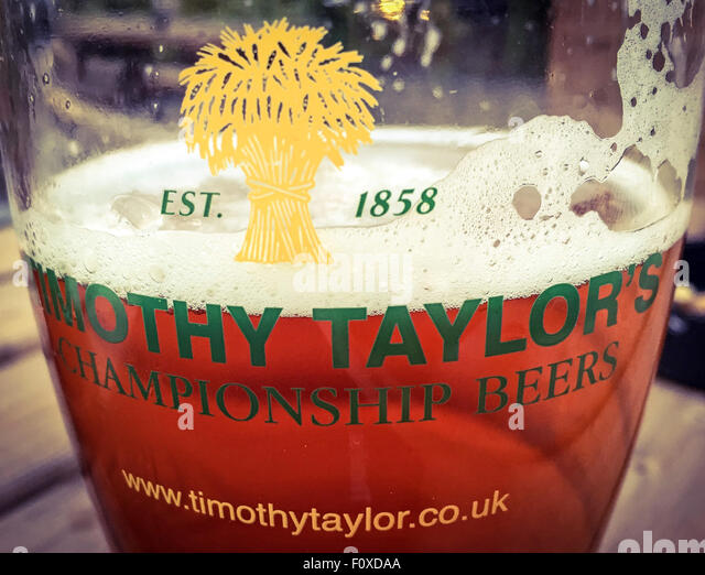 TT Timothy Taylor Championship Beers glass & ale, Yorkshire, England,UK - Stock Image
