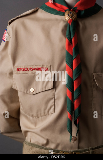 Classic Boy Scouts of America tan uniform with neckerchief and side - Stock Image