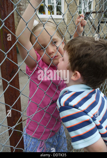 A child kissing another child - Stock Image