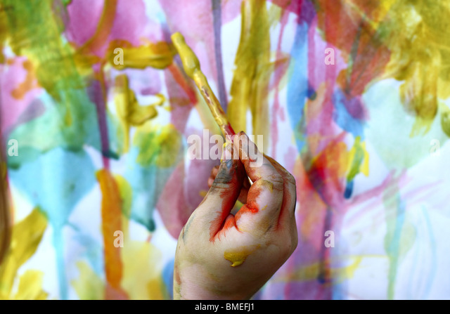 children little artist painting hand brush colorful watercolor art - Stock-Bilder