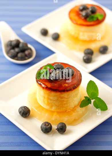 Cheese tart with honey and blueberries. Recipe available. - Stock Image
