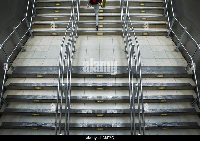 Train station stairs with metal railings at Paddington Station in London, England - Stock Image
