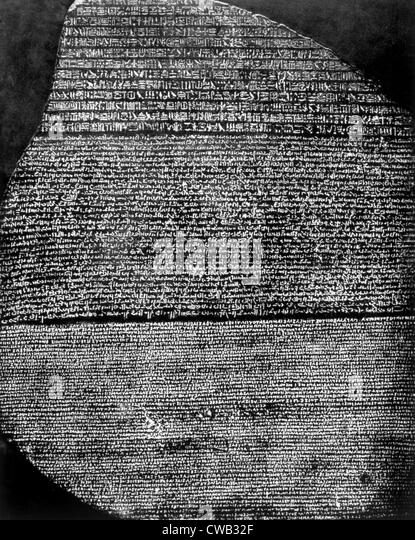 The Rosetta Stone, Basalt slab inscribed by priests of Ptolemy V in hieroglyphics, demonic and Greek, found by Napoleon's - Stock-Bilder