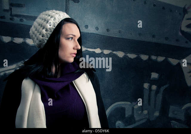 Woman in white hat standing near wall - Stock-Bilder