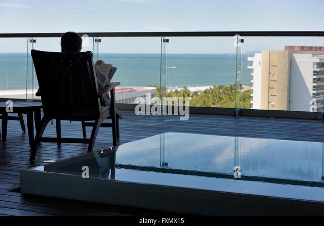 Balcony beach chair stock photos balcony beach chair for The balcony book
