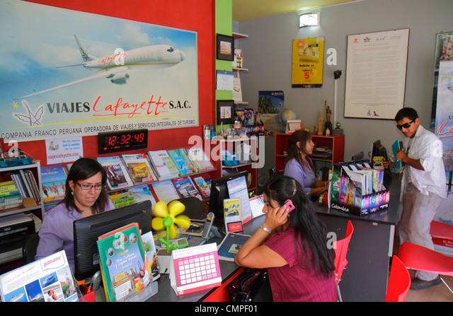 Peru Tacna Avenida Bolognese Viajes Lafayette business travel agency retailer airline trip travel arrangement desk - Stock Image