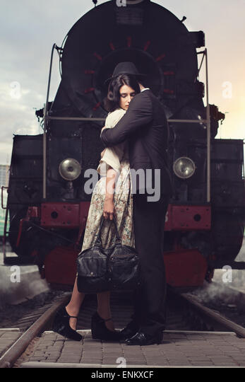 parting of lovely couple on railway station at locomotive background - Stock-Bilder