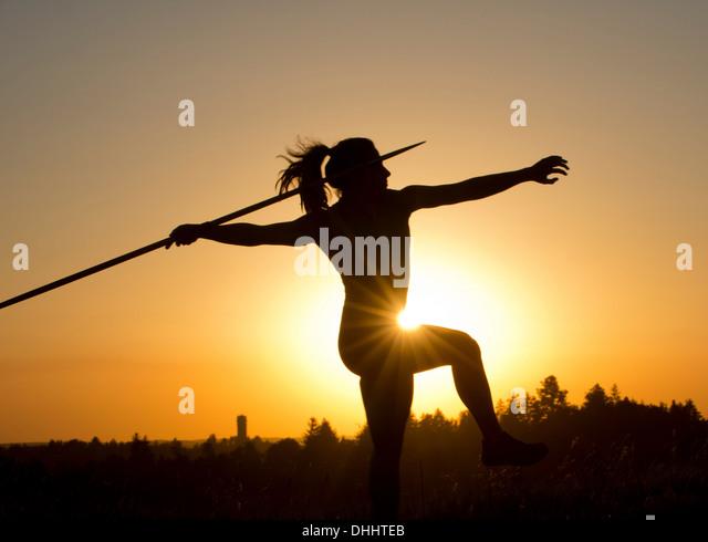 Athlete throwing javelin - Stock Image