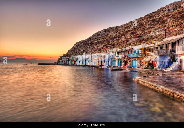 "Sunset at the fishermen houses with the impressive boat shelters, also known as ""syrmata"" in Klima of Milos, Greece - Stock Image"