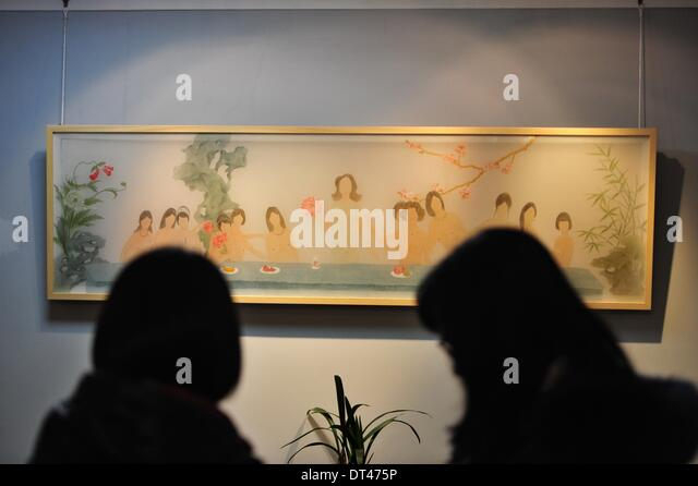 Wuhan, China's Hubei Province. 8th Feb, 2014. Visitors view a painting work during the 'Empathy/Illusion' - Stock Image