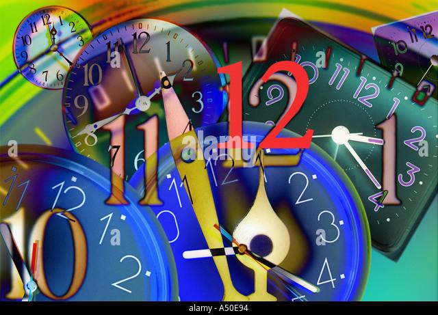 clock hands moving towards twelve o clock - Stock Image