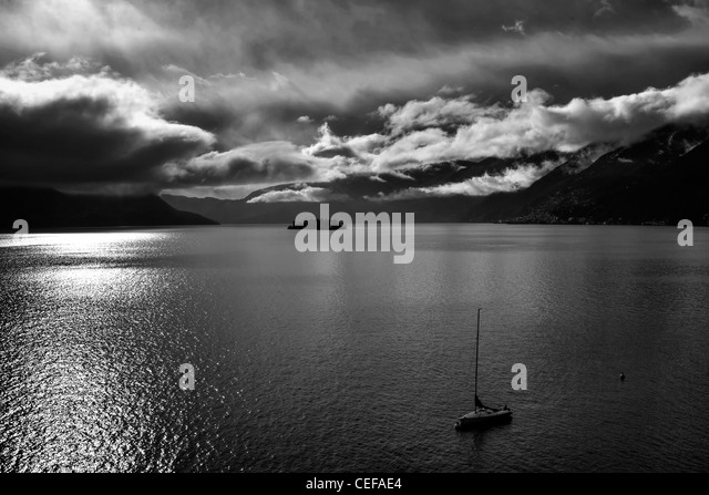 Clouds over the Lago Maggiore, which had formed after a rain in the winter. - Stock Image