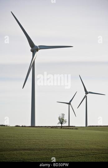 Wind Turbines in green landscape - Stock Image