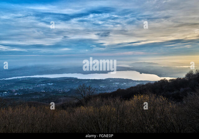 cold and hot lights at the sundown over the Varese Lake in autumn season, Lombardy - Italy - Stock Image