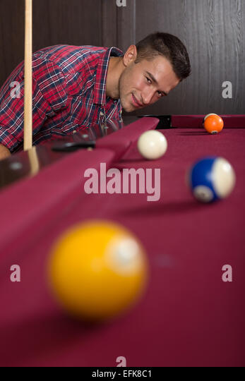 Young man playing billiard - Stock Image