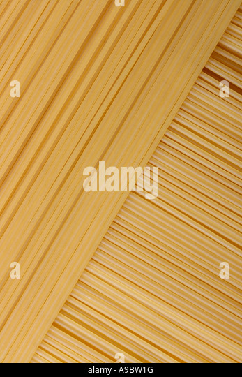 Fresh spaghetti lined up and overlapping at a perfect angle - Stock Image