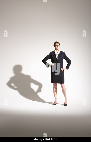 Businesswoman and shadow - Stock Image