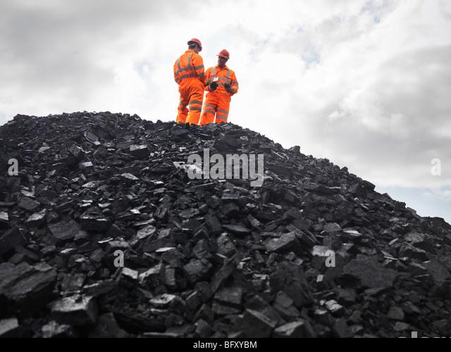 Coal Miners On Pile Of Coal - Stock Image
