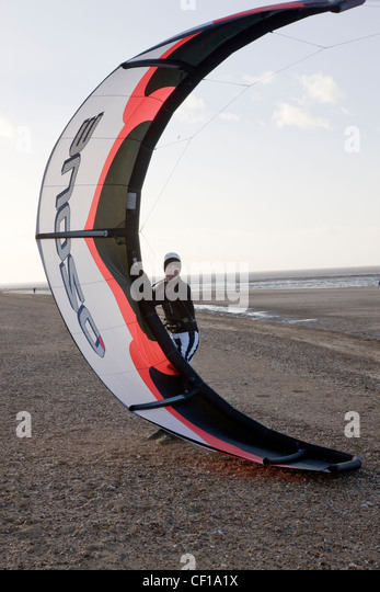 Wind surfing and kite surfing on the beach in Hunstanton, Norfolk - Stock Image