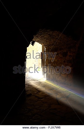 Sunlight Through Arch Door - Stock-Bilder